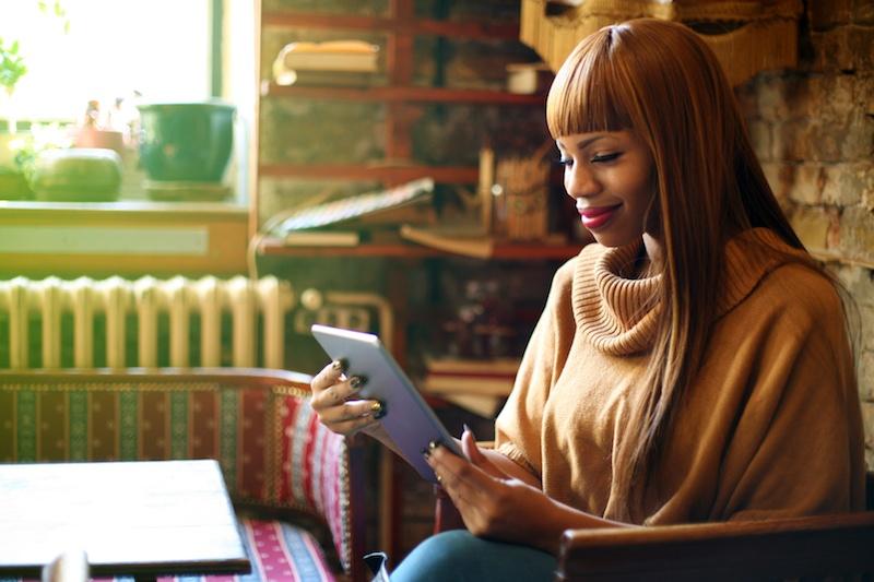 African-American-woman-working-on-digital-tablet.-539833844_3368x2245.jpeg