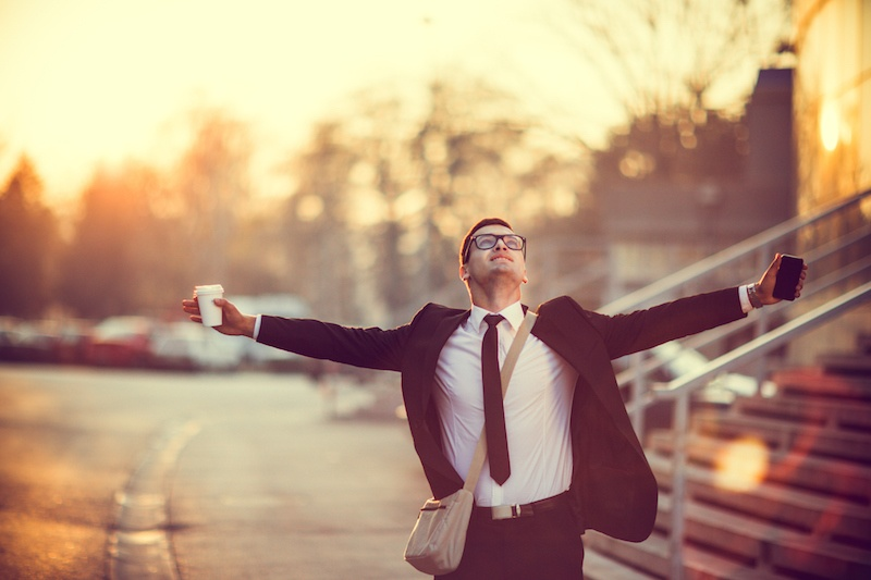 Businessman-smiling-with-arms-outstretched-502659354_2125x1416.jpeg