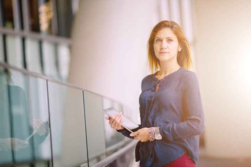 Determined-business-woman-in-modern-office-building-with-laptop-586065674_2122x1416.jpeg