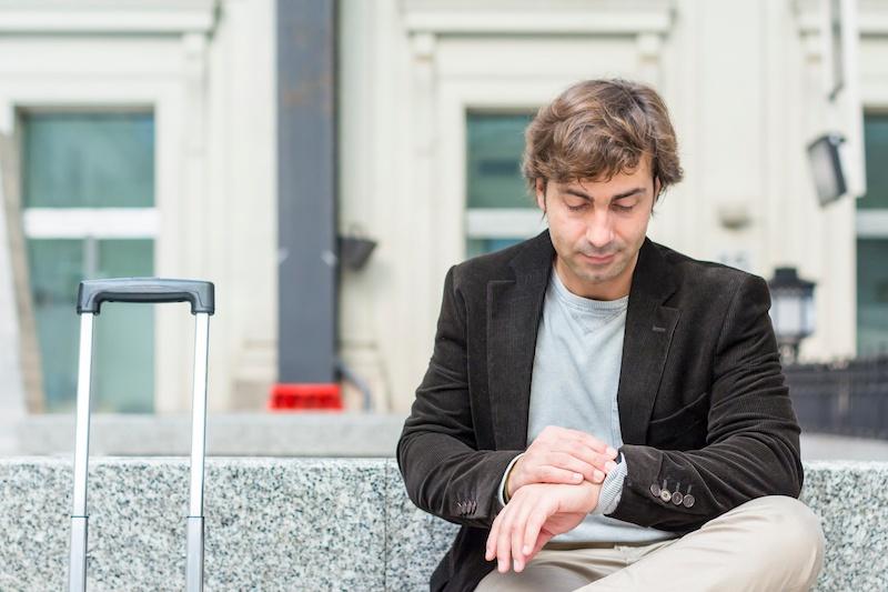 Man-waiting-at-train-station-627303618_3000x2000.jpeg