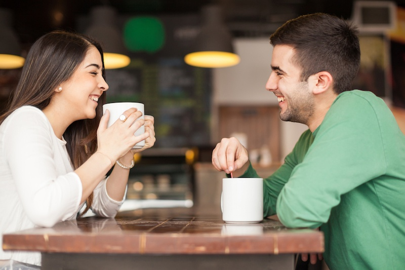 Young-couple-having-fun-at-a-cafe-519397482_2125x1416.jpeg